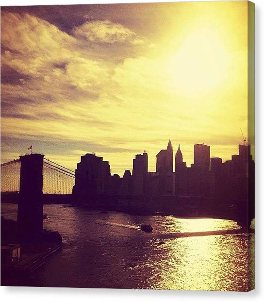 Skylines Canvas Print - Sunset Over The New York City Skyline And The Brooklyn Bridge by Vivienne Gucwa