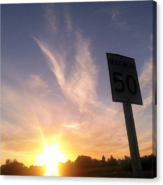 Manitoba Canvas Print - #sunset #roadsigns #skypainters by Michael Squier