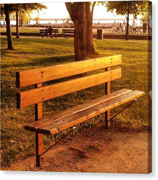 Colourful Canvas Print - Sunset Viewing Post. #bench #sunlight by Jess Gowan