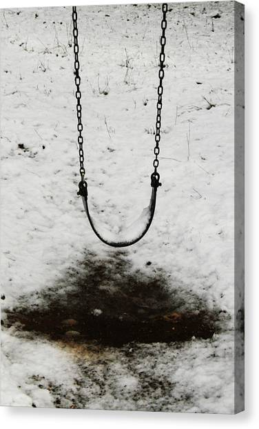 Swing In Snow Canvas Print
