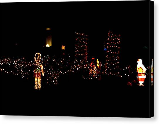Teakwood Island Toy Soldier To Standing Santa Canvas Print by John Wright