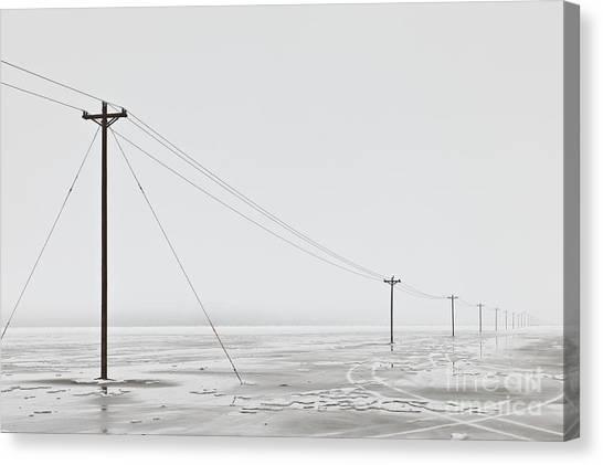 Telephone Poles In Bleak Winter Landscape Canvas Print by Dave & Les Jacobs