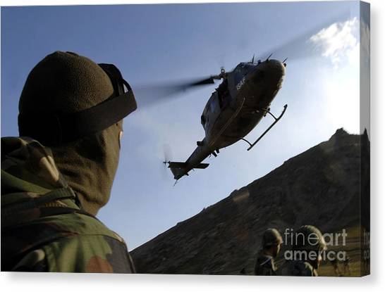 Medivac Canvas Print - The Arrival Of An Italian Uh-60 by Stocktrek Images