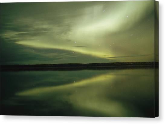 Northwest Territories Canvas Print - The Aurora Borealis Is Reflected by Raymond Gehman