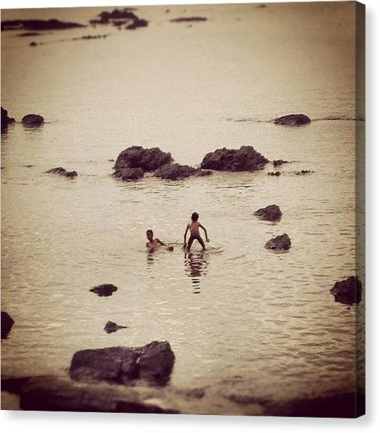 Innocent Canvas Print - The Sea Is A Child's Infinity Pool by Pushkaraj Shirke