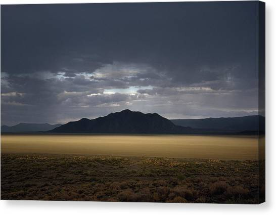Black Rock Desert Canvas Print - The Setting Sun Permeates Rain Clouds by James P. Blair