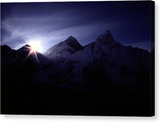 Mount Everest Canvas Print - The Sun Rising Over The Snow-covered by Tim Laman