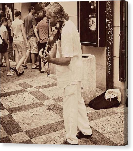 Violins Canvas Print - The Violin Player #man #praha #prague by Sabrina Raber