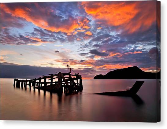 The Wreck In Sea With Fantastic Sky Canvas Print by Arthit Somsakul
