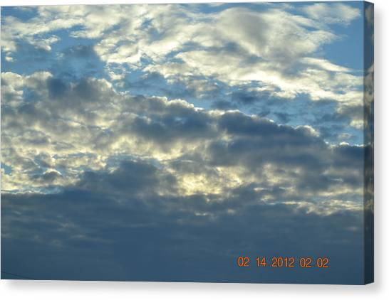 Thick Clouds Canvas Print by Heidi Frye