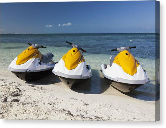 Water Skis Canvas Print - Three Jet Skis On The Beach At Cancun by Bryan Mullennix
