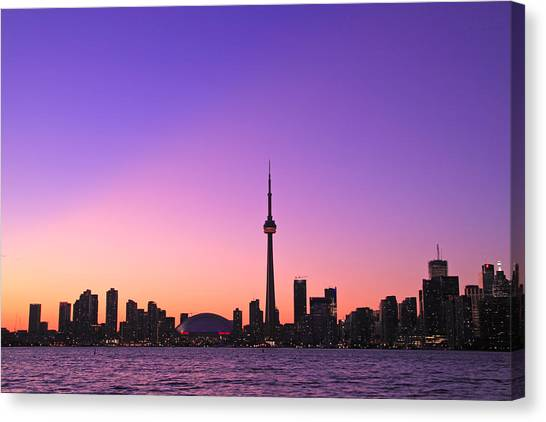Toronto Purple Skyline Canvas Print by Aqnus Febriyant