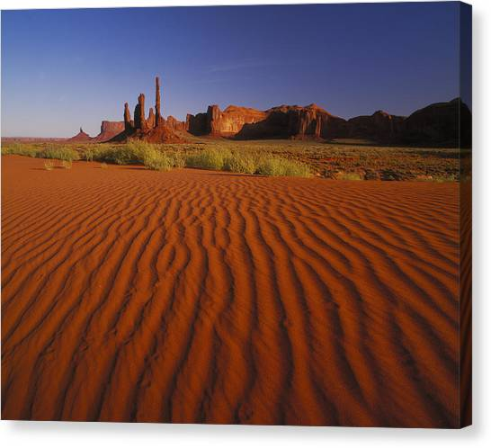 Totem Pole Rocks, Monument Valley Canvas Print by Brian Lawrence