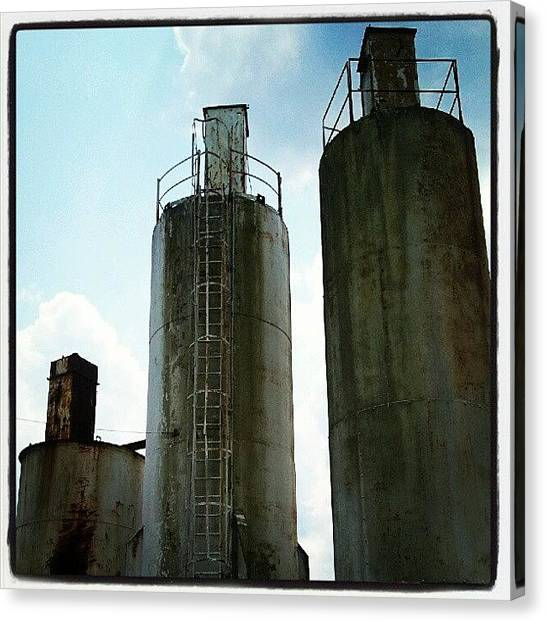 Tanks Canvas Print - #towers #industrial #tanks #tall #three by Tracy Hager