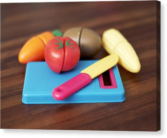 Toy Vegetable Chopping Board Canvas Print by Ian Boddy