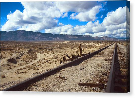 Track To The Mountains Canvas Print by Jeffery Reynolds