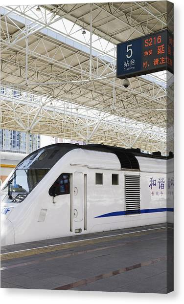 Bullet Trains Canvas Print - Train Platform And A High Speed Train by Roberto Westbrook