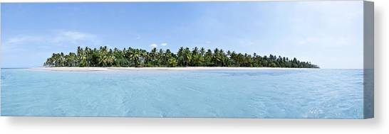 Tropical Island Floating Over Turquoise Water Canvas Print