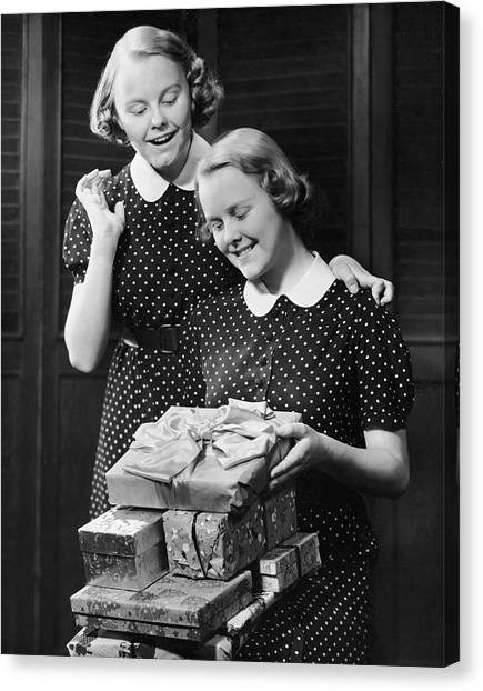 Twin Teenage Girls W/ Wrapped Gifts Canvas Print by George Marks