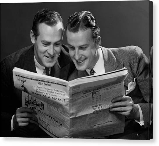 Two Businessmen Reading Newspaper Canvas Print by George Marks