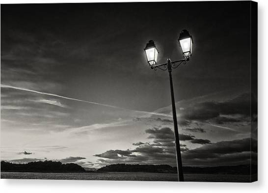 Two Lights At The Sunset Canvas Print by Philippe Taka