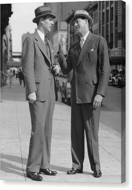Two Men Talking On Street Canvas Print by George Marks