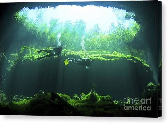 Underwater Caves Canvas Print - Two Scuba Divers In The Cenote System by Karen Doody