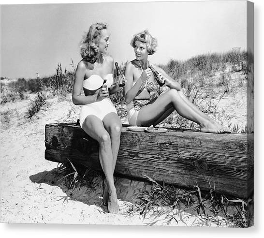 Two Women Drinking Soda On Beach Canvas Print by George Marks