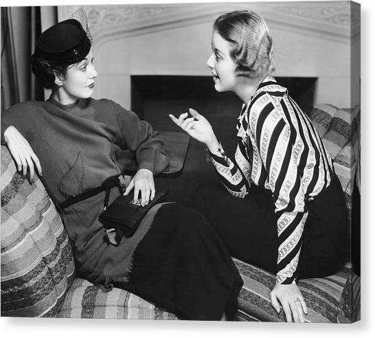 Two Women In Casual Conversation Canvas Print by George Marks
