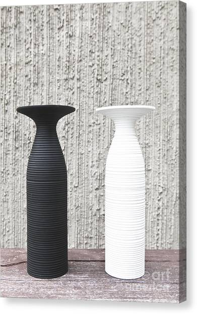 twoWhite and black vases Canvas Print by Chavalit Kamolthamanon