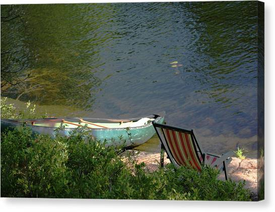 Typical Canoe And Chair Canvas Print by Carolyn Reinhart
