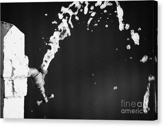Upside Down Faucet Spraying Water Canvas Print by Joe Fox