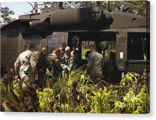 Medivac Canvas Print - U.s. Army Soldiers Load A Patient Onto by Stocktrek Images