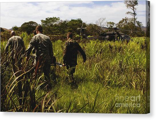 Medivac Canvas Print - U.s. Army Soldiers Transport A Patient by Stocktrek Images