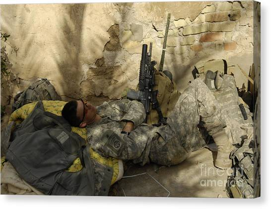 Minotaurs Canvas Print - U.s. Army Specialist Takes A Nap by Stocktrek Images