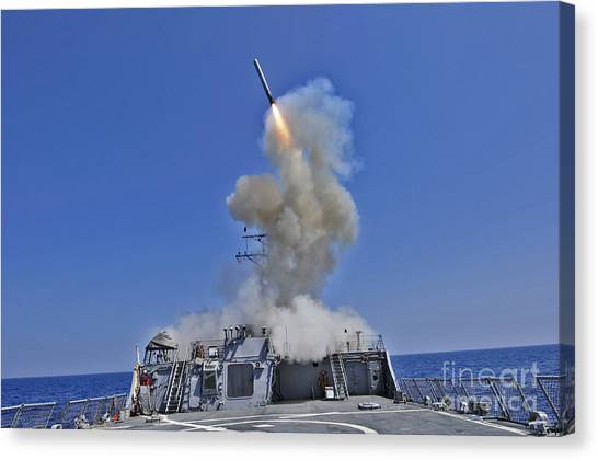 Warheads Canvas Print - Uss Barry Launches A Tomahawk Cruise by Stocktrek Images