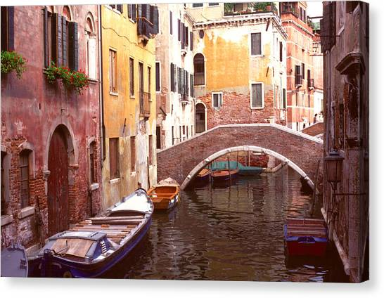 Venice Bridge Over A Small Canal. Canvas Print