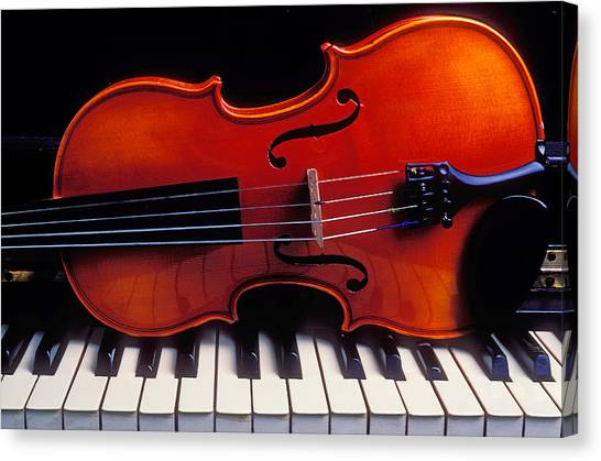 Stringed Instruments Canvas Print - Violin On Piano Keys by Garry Gay