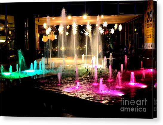 Water Fountain With Stars And Blue Green With Pink Lights Canvas Print