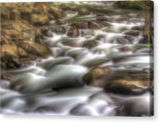 Water On The Rocks Canvas Print by Barry Jones