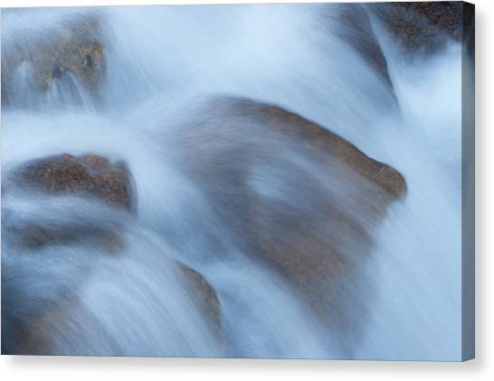 Water Over Rocks Canvas Print by Maureen Bates
