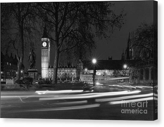 Westminster Night Traffic  Canvas Print by Aldo Cervato