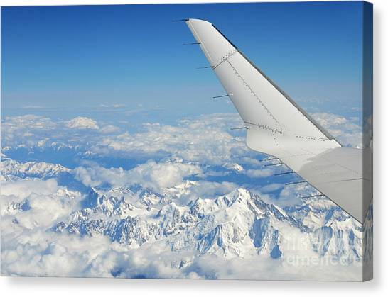 Wings Of Flying Airplane Over French Alps Canvas Print by Sami Sarkis
