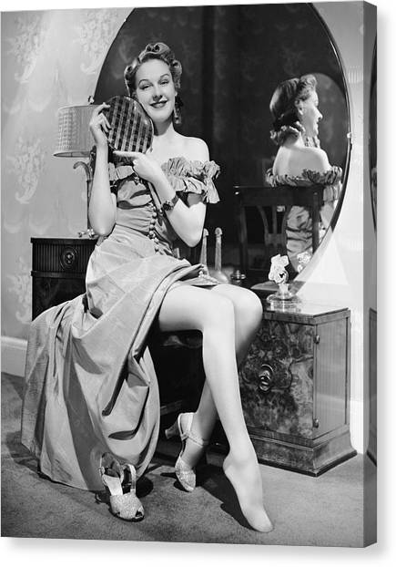 Woman At Dressing Table Holding Mirror Canvas Print by George Marks