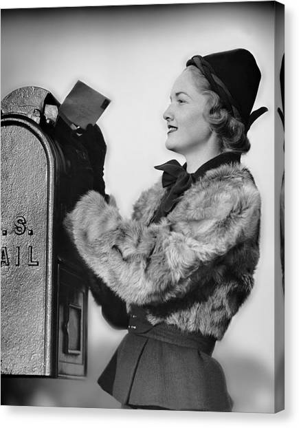 Woman Dropping Letter Into Mailbox Canvas Print by George Marks
