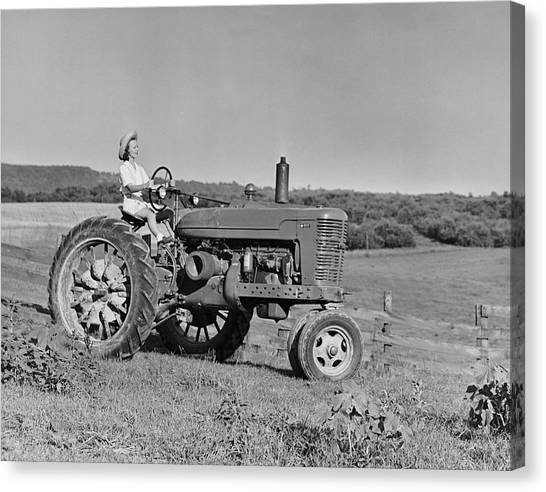 Woman Farmer Driving Tractor Canvas Print by George Marks