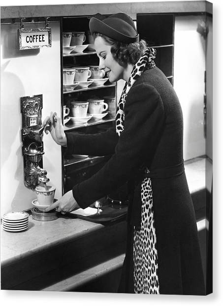 Woman Getting Coffee At Old Fashioned Machine Canvas Print by George Marks