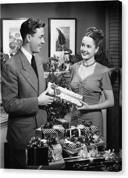 Woman Giving Gift To Man, (b&w) Canvas Print by George Marks