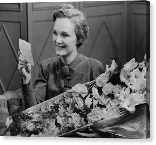Woman Holding Flower Arrangement, Reading Card, (b&w) Canvas Print by George Marks