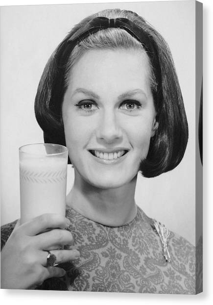 Woman Holding Glass Of Milk Canvas Print by George Marks